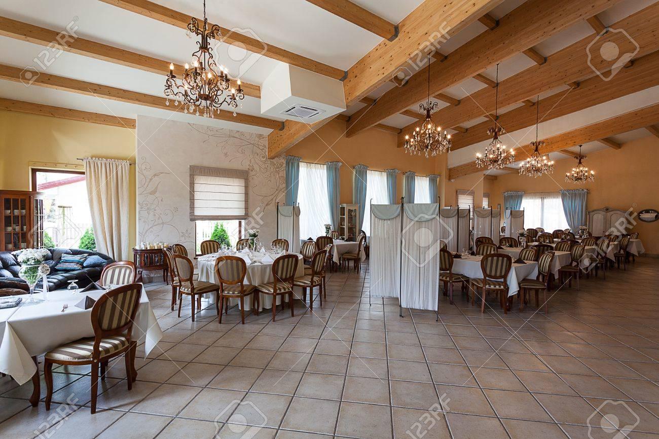 Mediterranean interior - an elegant restaurant with wooden details Stock Photo - 21822150
