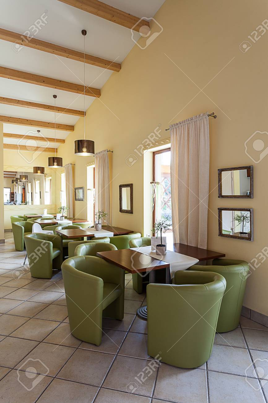 Mediterranean interior - a waiting room with tables and armchairs Stock Photo - 21822486