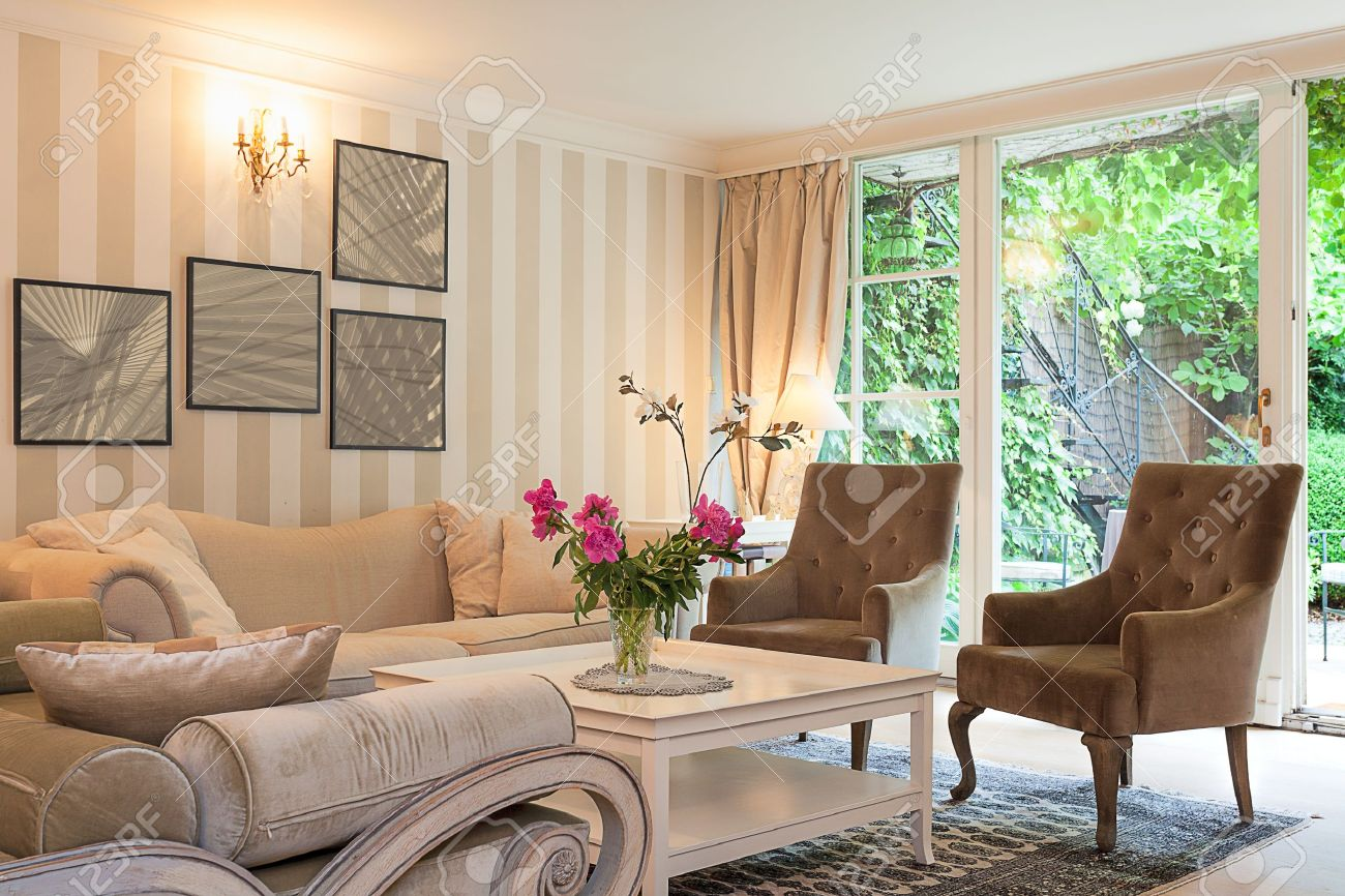vintage mansion a luxurious suite in a beige living room stock