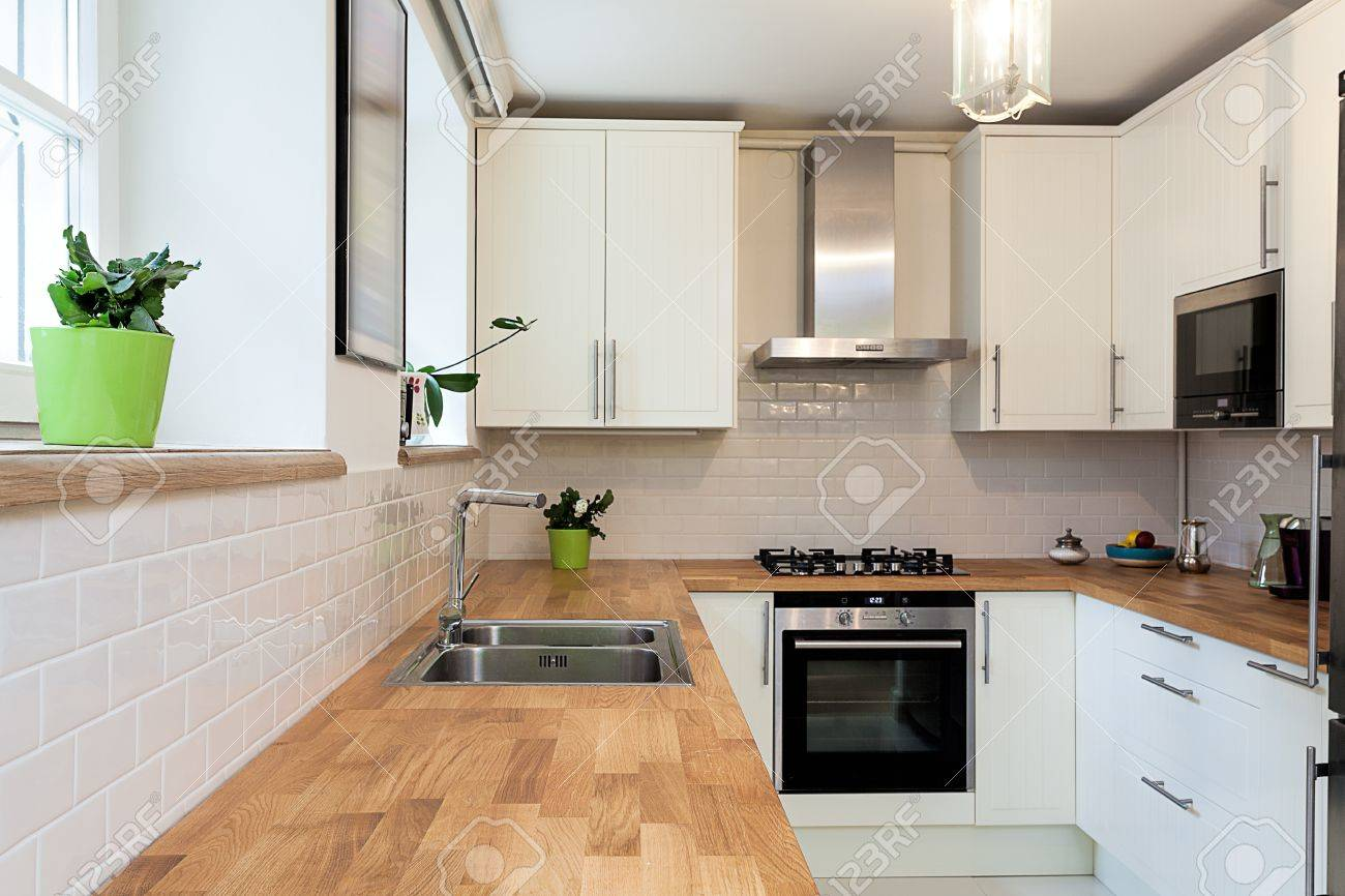 Vintage mansion - a wooden countertop in a white kitchen Stock Photo - 22059024