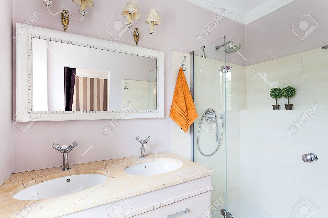 Vintage mansion - a bright rest room with a glass shower and stone sinks Stock Photo - 22183462