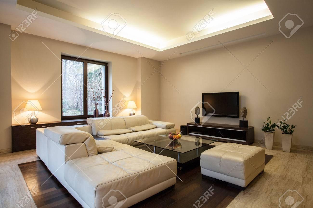 travertine house: horizontal view on arranged living room stock