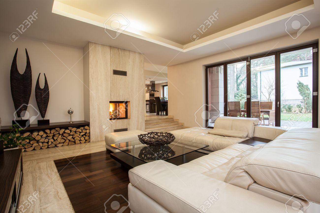 Travertine house: contemporary living room with fireplace Stock Photo - 22418225