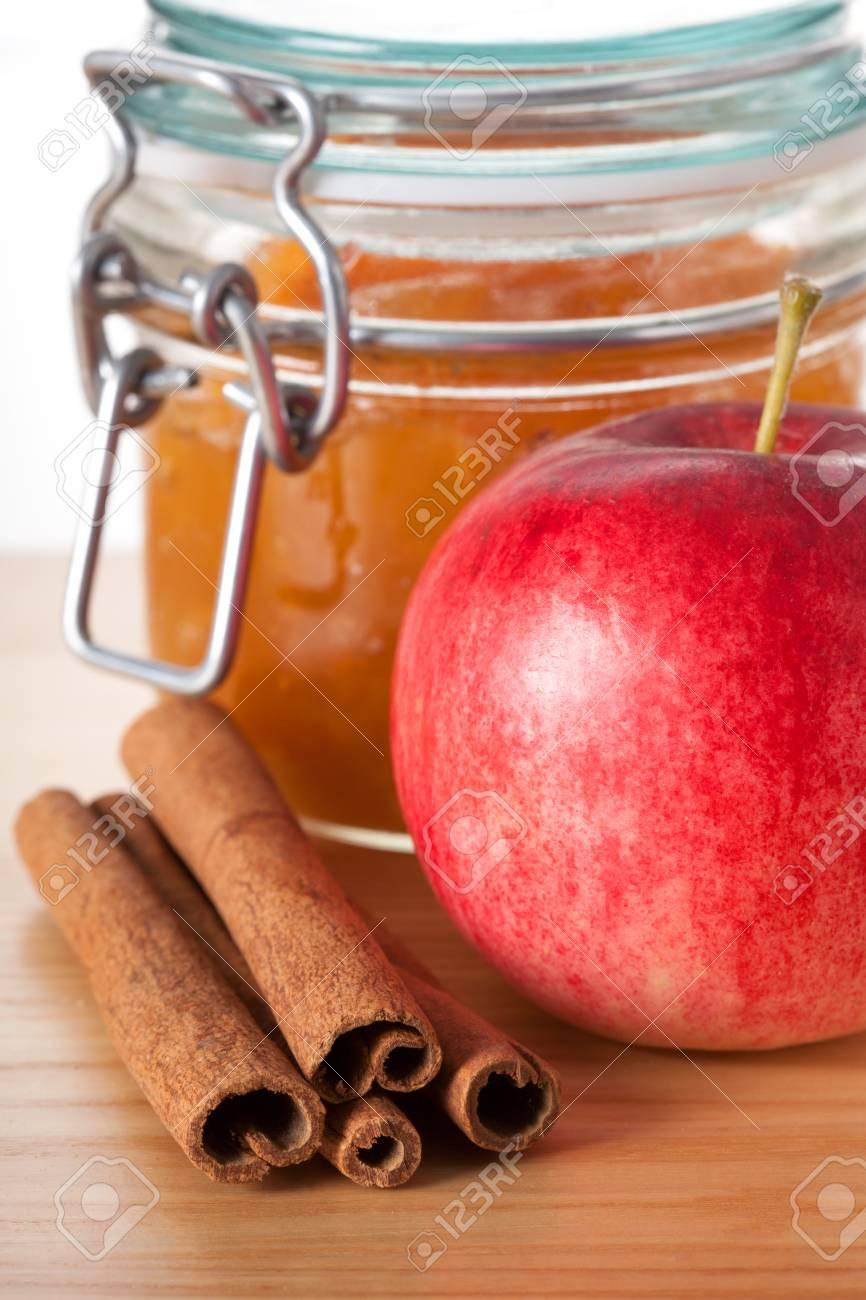 Closeup of an apple, cinnamon and jar of jam Stock Photo - 23007207