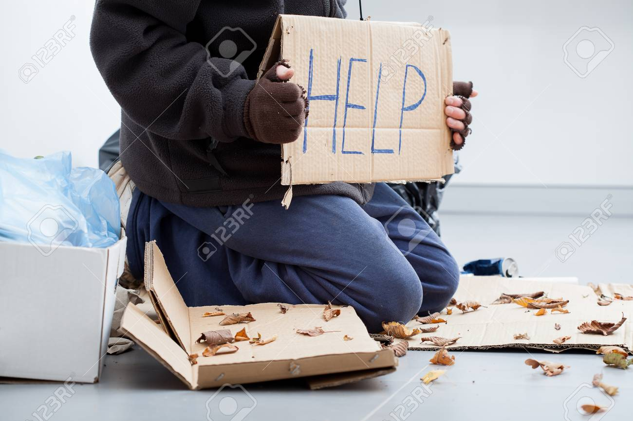 Homeless man on a street begging for benefit Stock Photo - 23049395