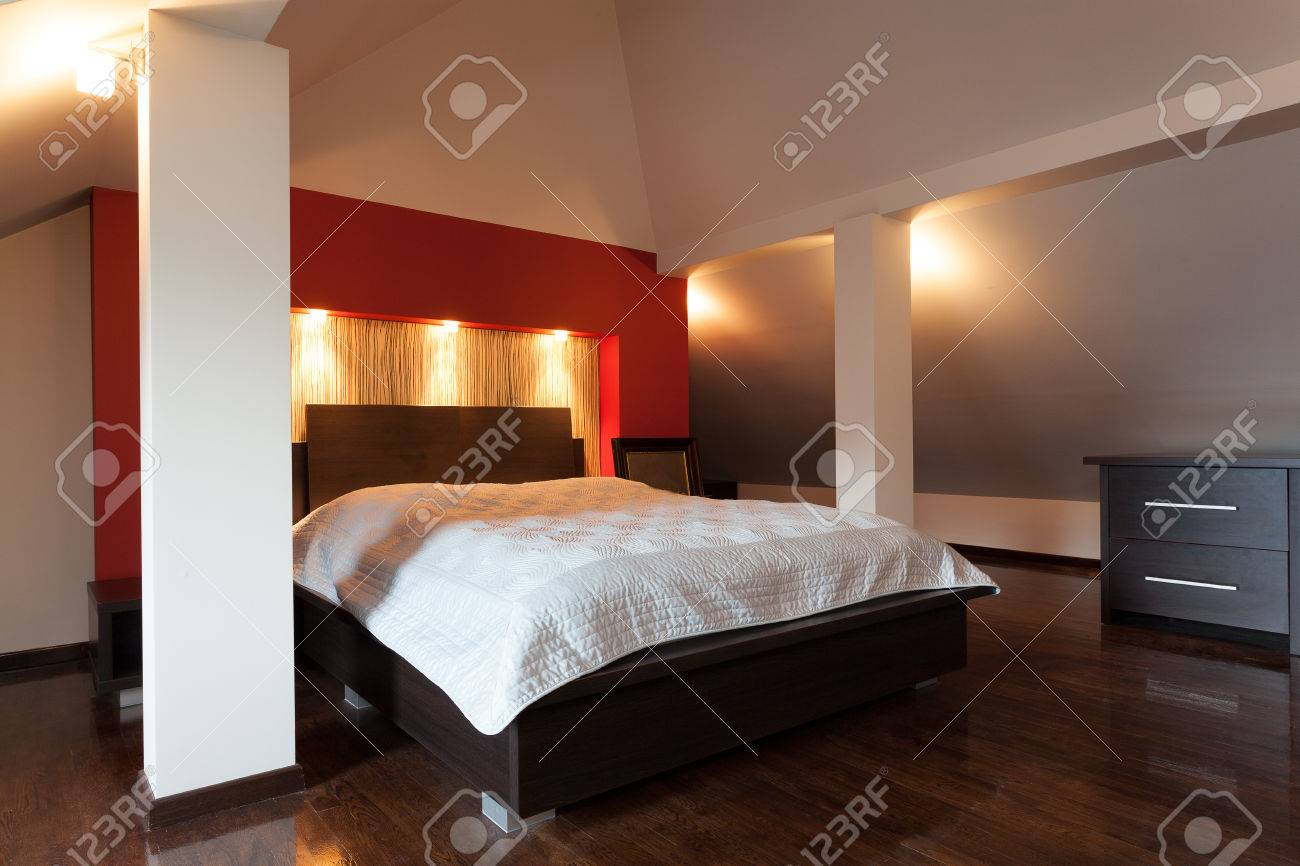 Double bed in a modern designed bedroom Stock Photo - 23033917