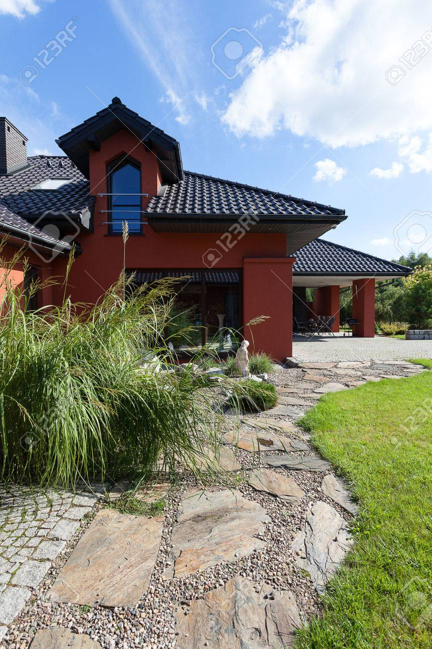 Stone path in a garden of the huge mansion Stock Photo - 23033958