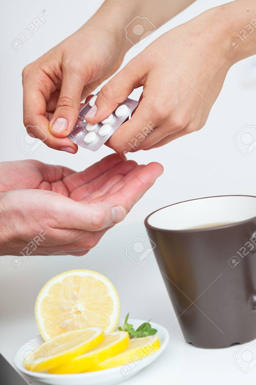 Giving medications to a patient who's got a flu Stock Photo - 23256344