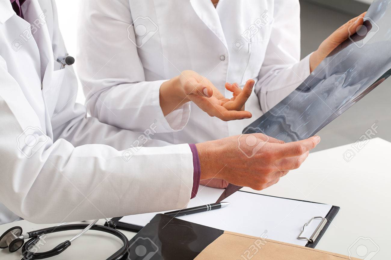Physicians discussing about patients tests result Stock Photo - 23256494