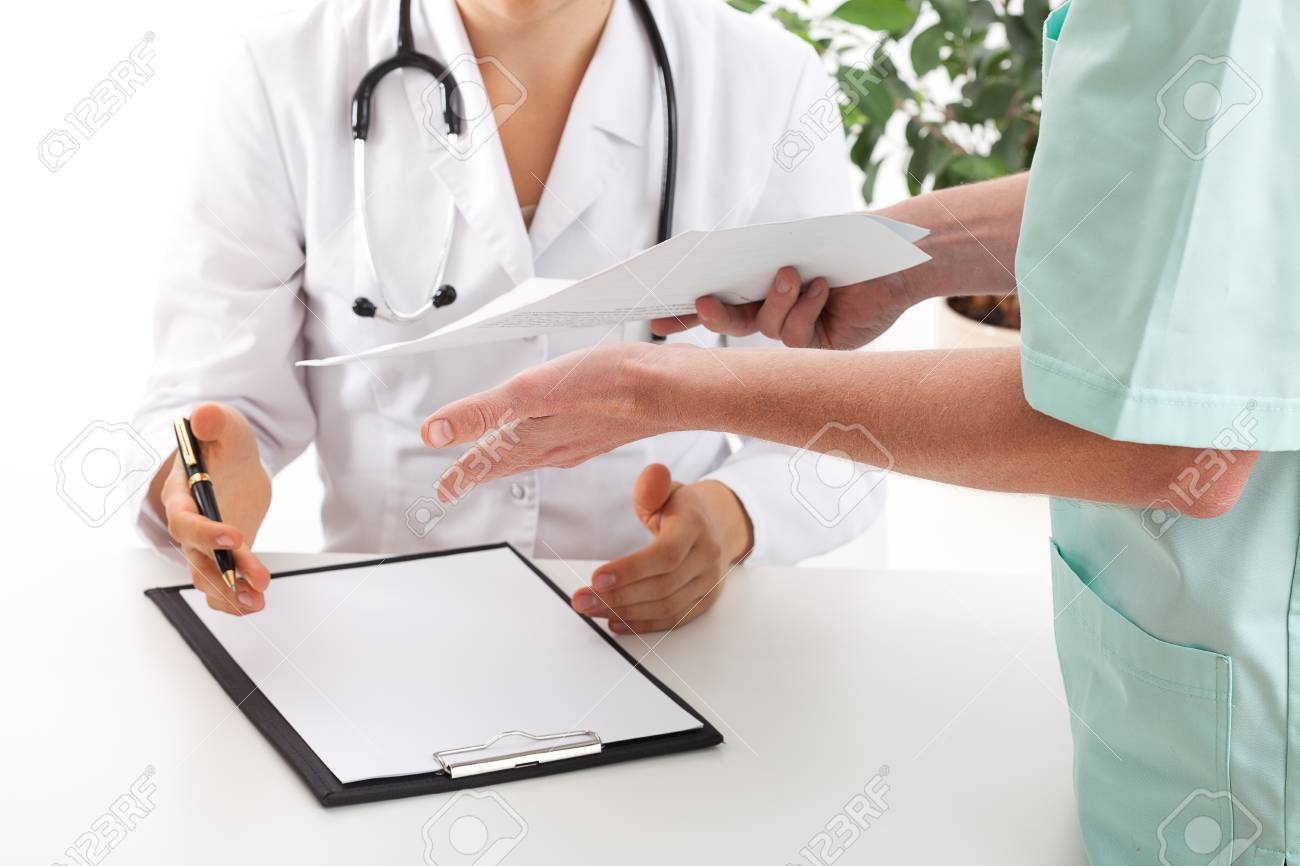 A nurse giving patient's test result to a doctor Stock Photo - 23256499