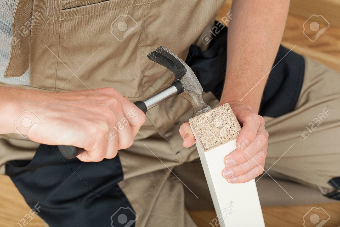 Magnificent Handyman Repairing Broken Table Leg With A Hammer Interior Design Ideas Clesiryabchikinfo