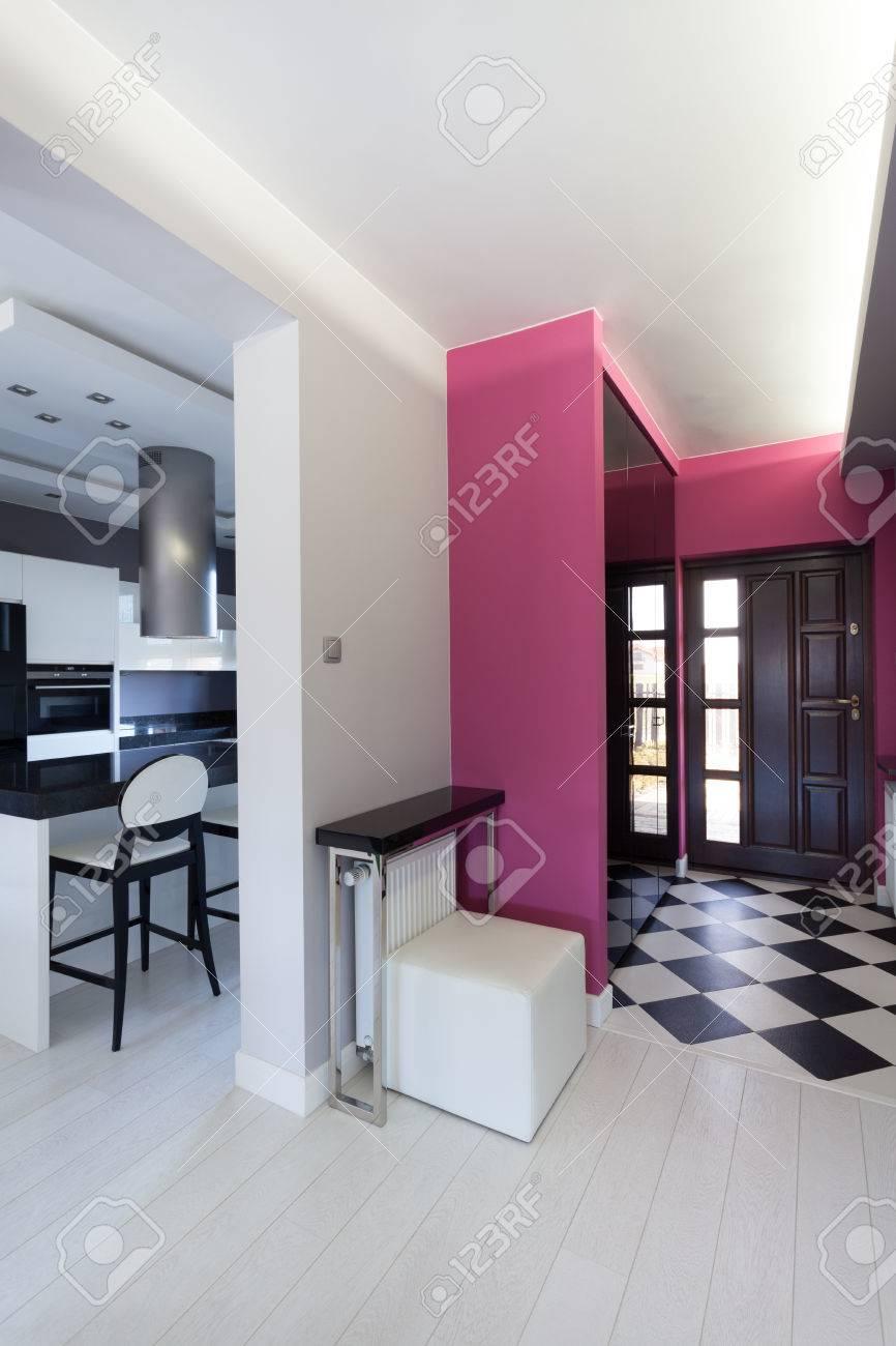Vibrant cottage - pink corridor and white kitchen Stock Photo - 23699302