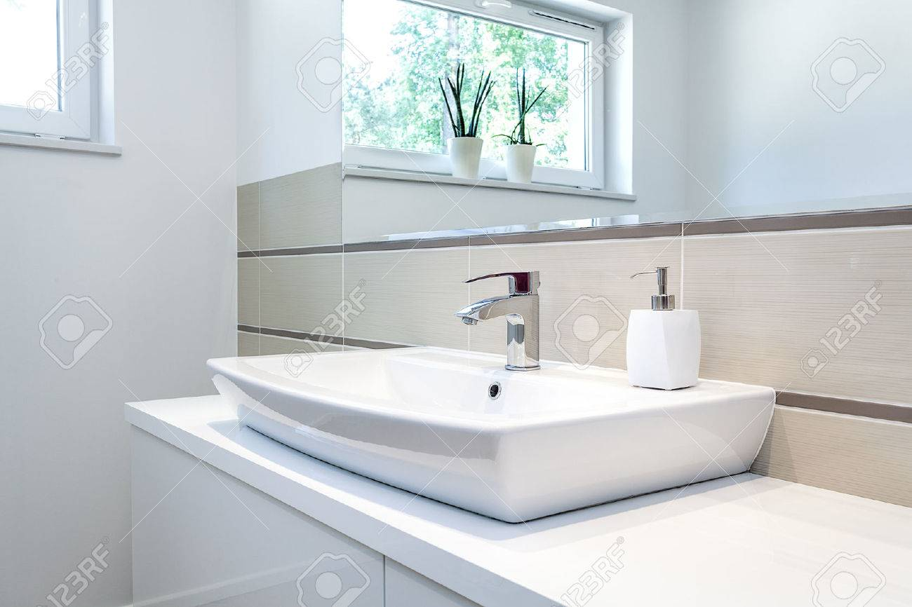 White bathroom faucet - Bright Space A Silver Tap In A White Bathroom Stock Photo 24026102