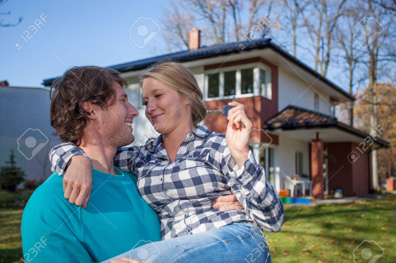 Young man moving into a new house with his wife Stock Photo - 24026315