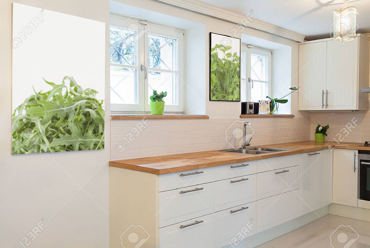 Vintage mansion - a white cooking area with pictures on walls Stock Photo - 24368960