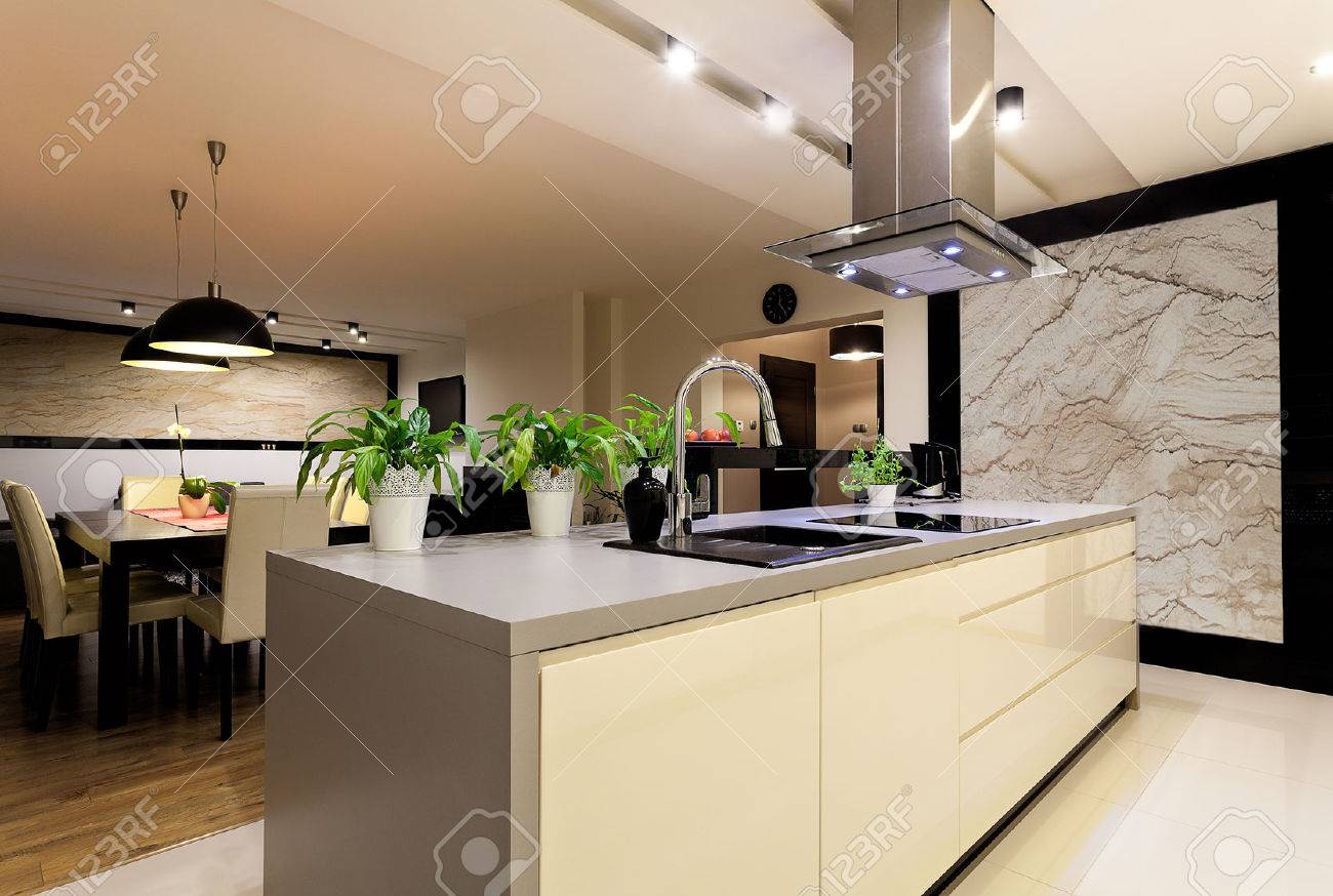urban apartment - kitchen interior with travertine wall stock