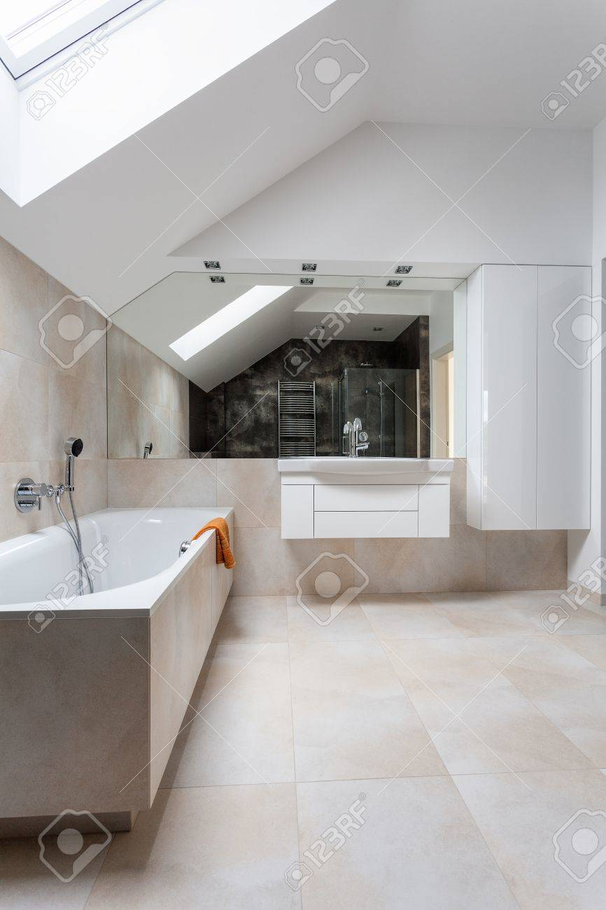 Bright Bathroom With Huge Bath And Mirror Stock Photo, Picture And ...