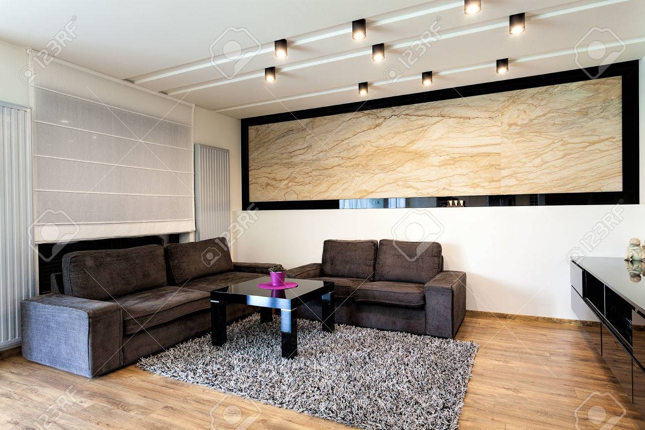 urban apartment - travertine on a wall in living room stock photo
