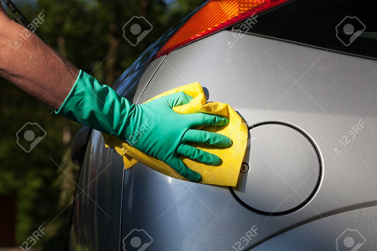 A man polishing a silver car with a rag Stock Photo - 24824482