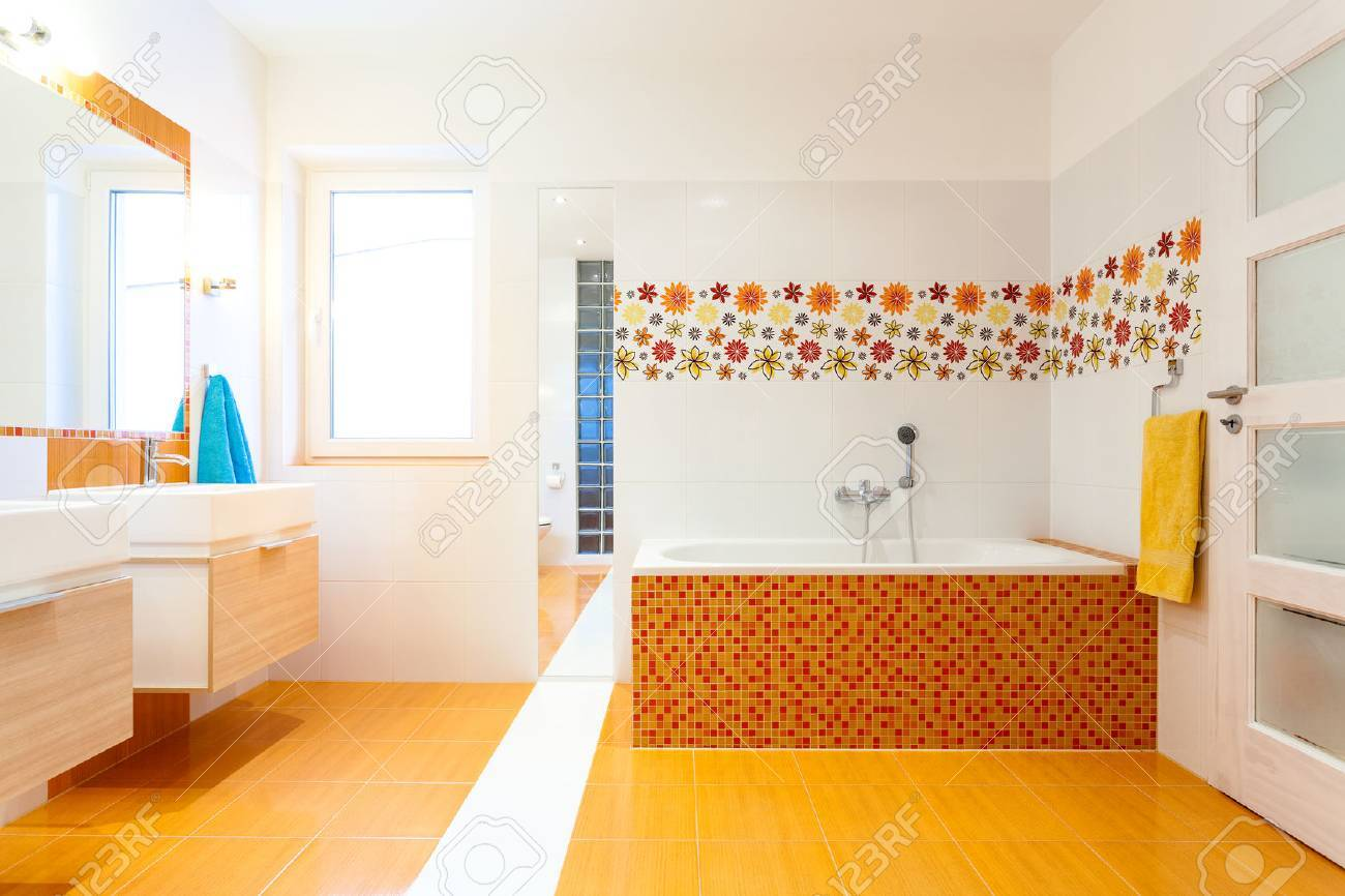 New Contemporary Bathroom With White And Orange Tiles Stock Photo ...