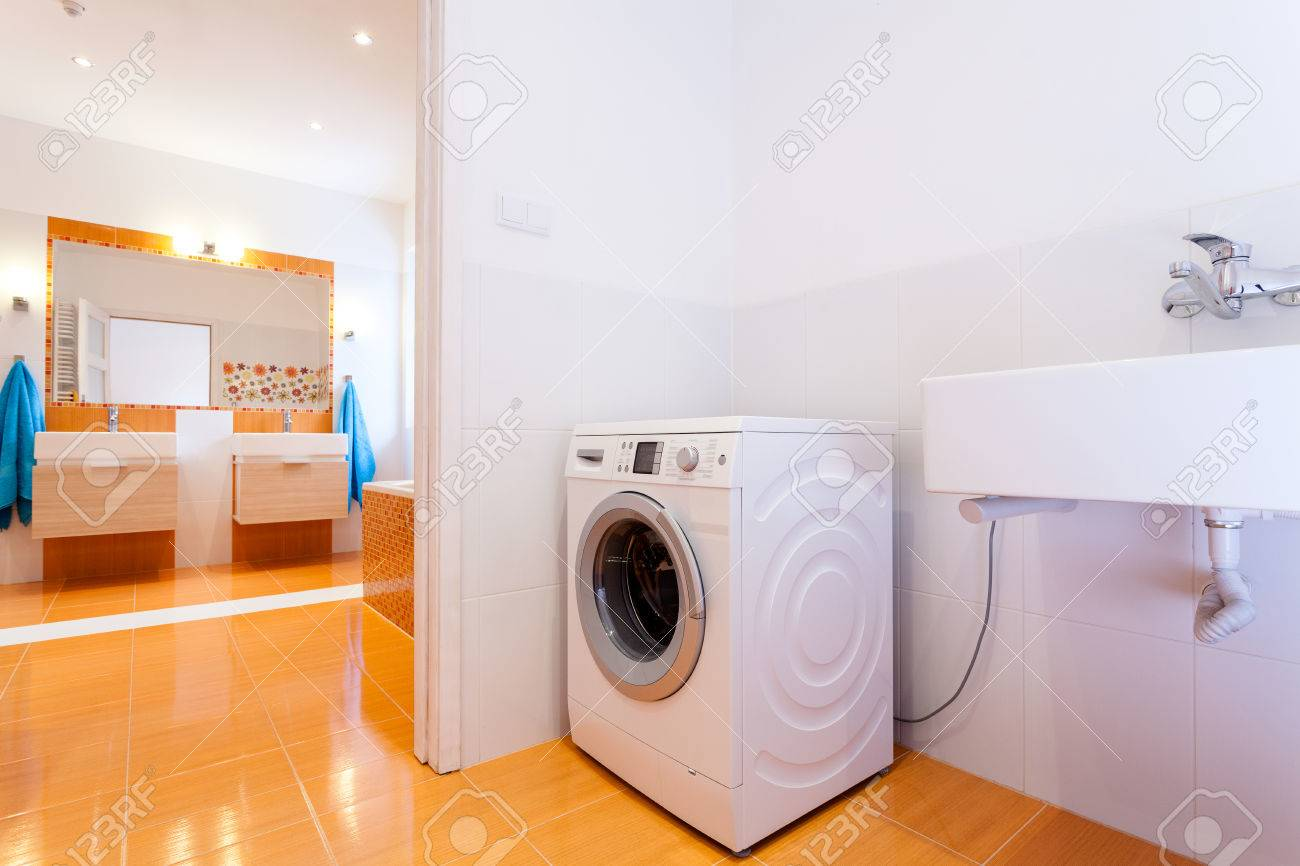 Big comfortable practical bathroom with washing machine at big house Stock Photo - 25626923