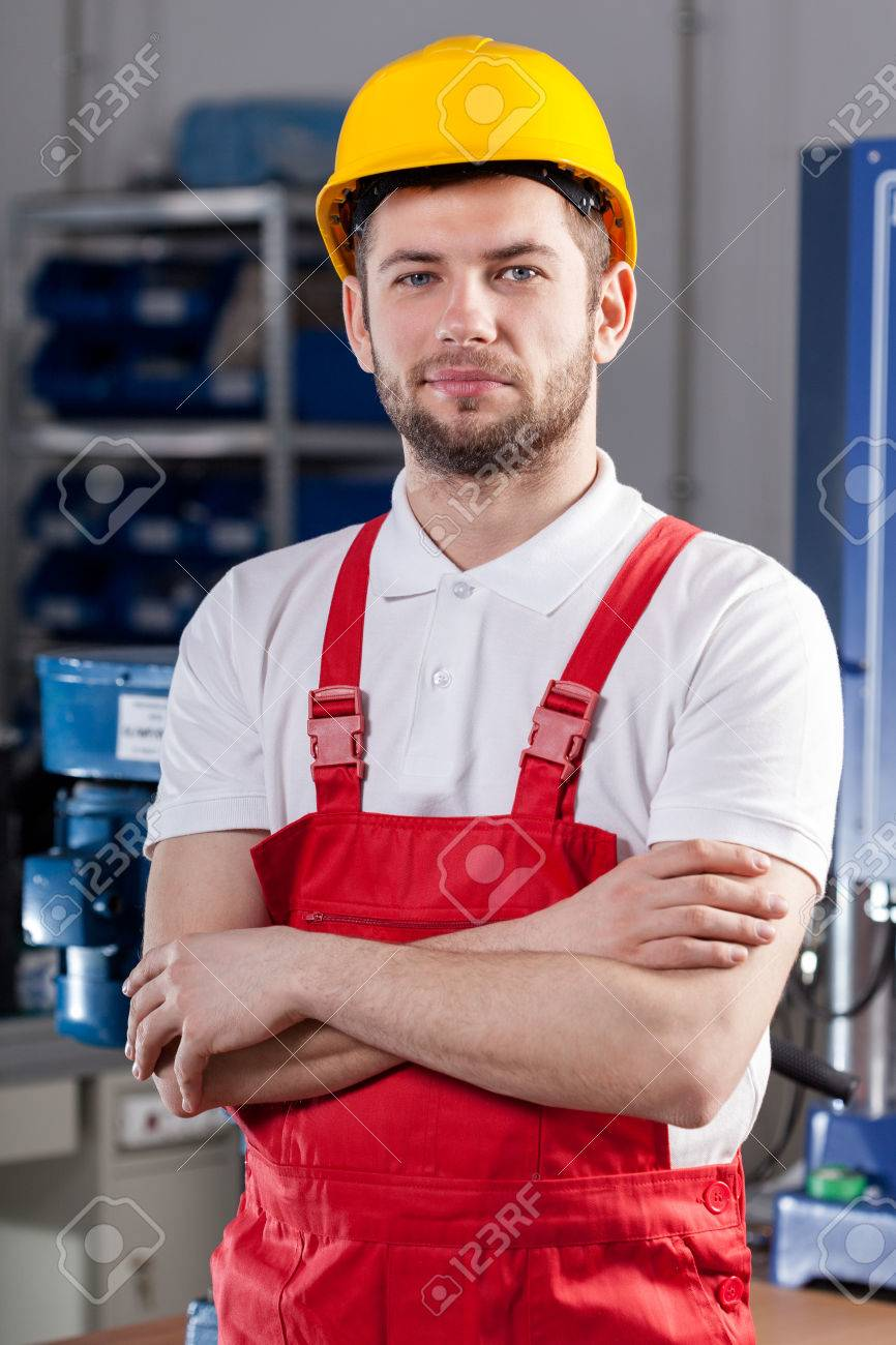 Young Production Worker During Job In Factory Photo Picture – Production Worker