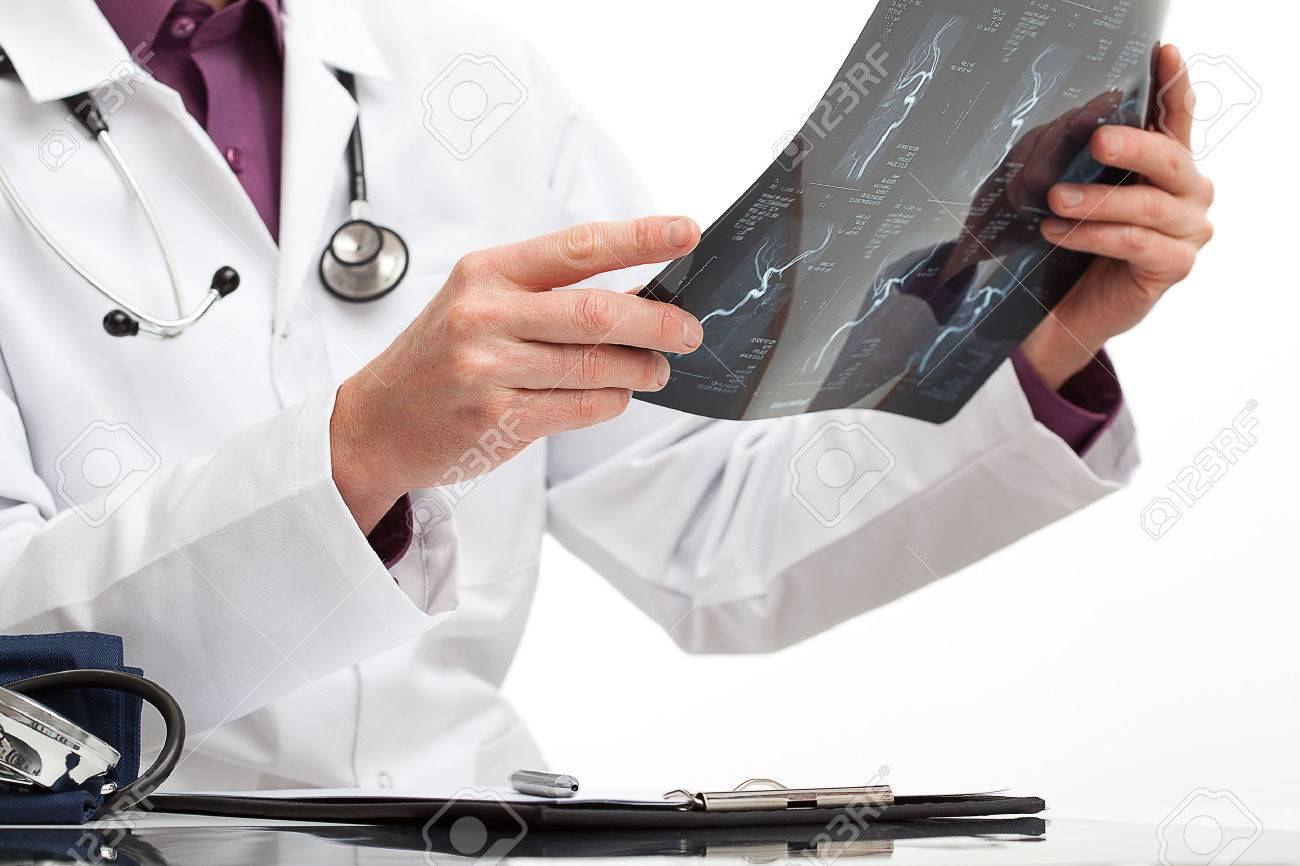 Doctor is making a diagnosis for a patient in medical office - 26312766