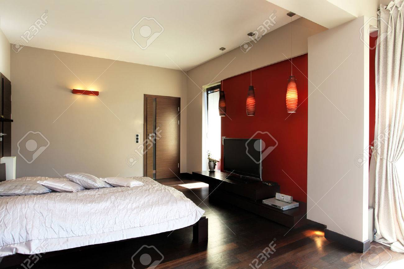 An Elegant King S Bedroom With A Big Bed And A Red Wall Stock Photo Picture And Royalty Free Image Image 26388629
