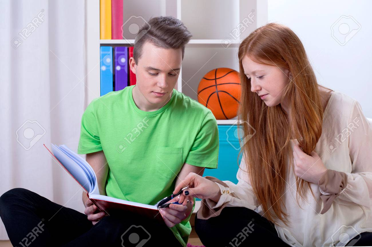 Couple of teenage friends learning together at home Stock Photo - 26806823