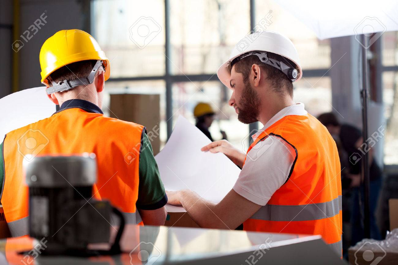 supervisor stock photos images royalty supervisor images and supervisor male factory worker and supervisor are analyzing plans