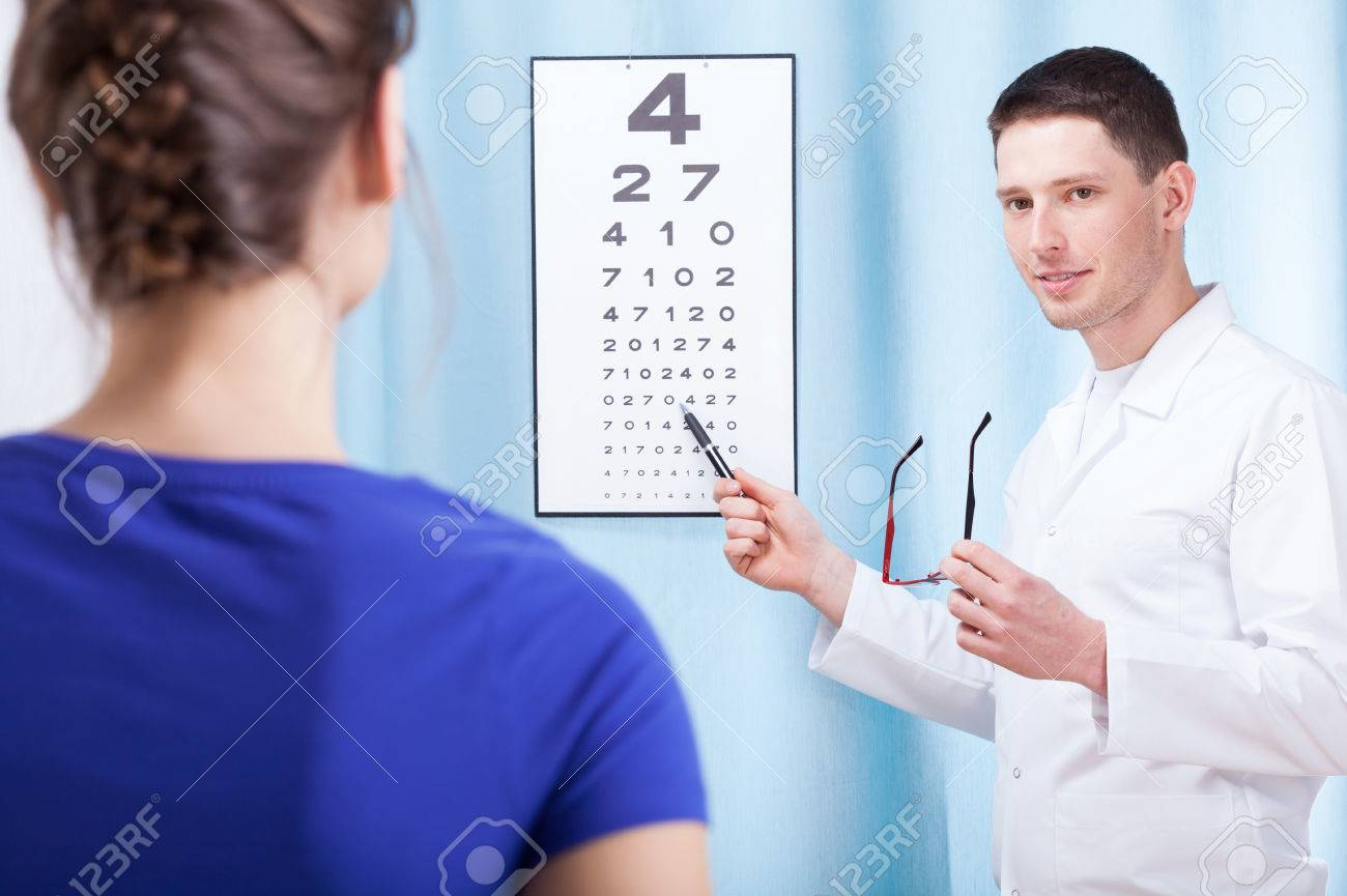 425275f047d Young oculist doctor examining patient with table Stock Photo - 27542620