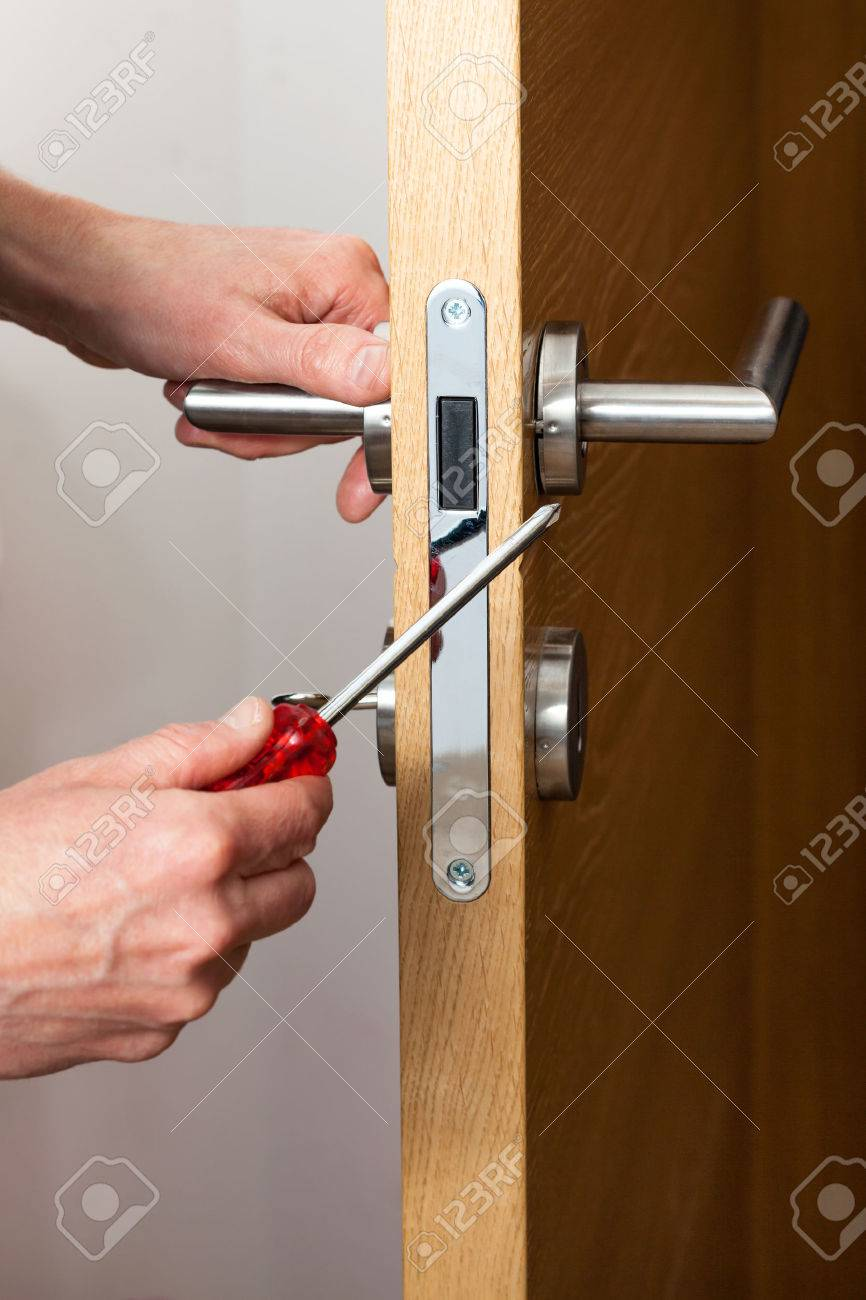 Hands repairing a door lock with a screwdriver Stock Photo - 29189594 & Hands Repairing A Door Lock With A Screwdriver Stock Photo ...