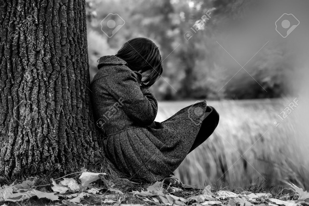Sad woman crying after break up in the park stock photo 31533672