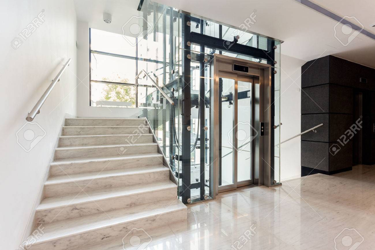 Charming Hall With Staircase And Elevator Inside The Building Stock Photo   33099842