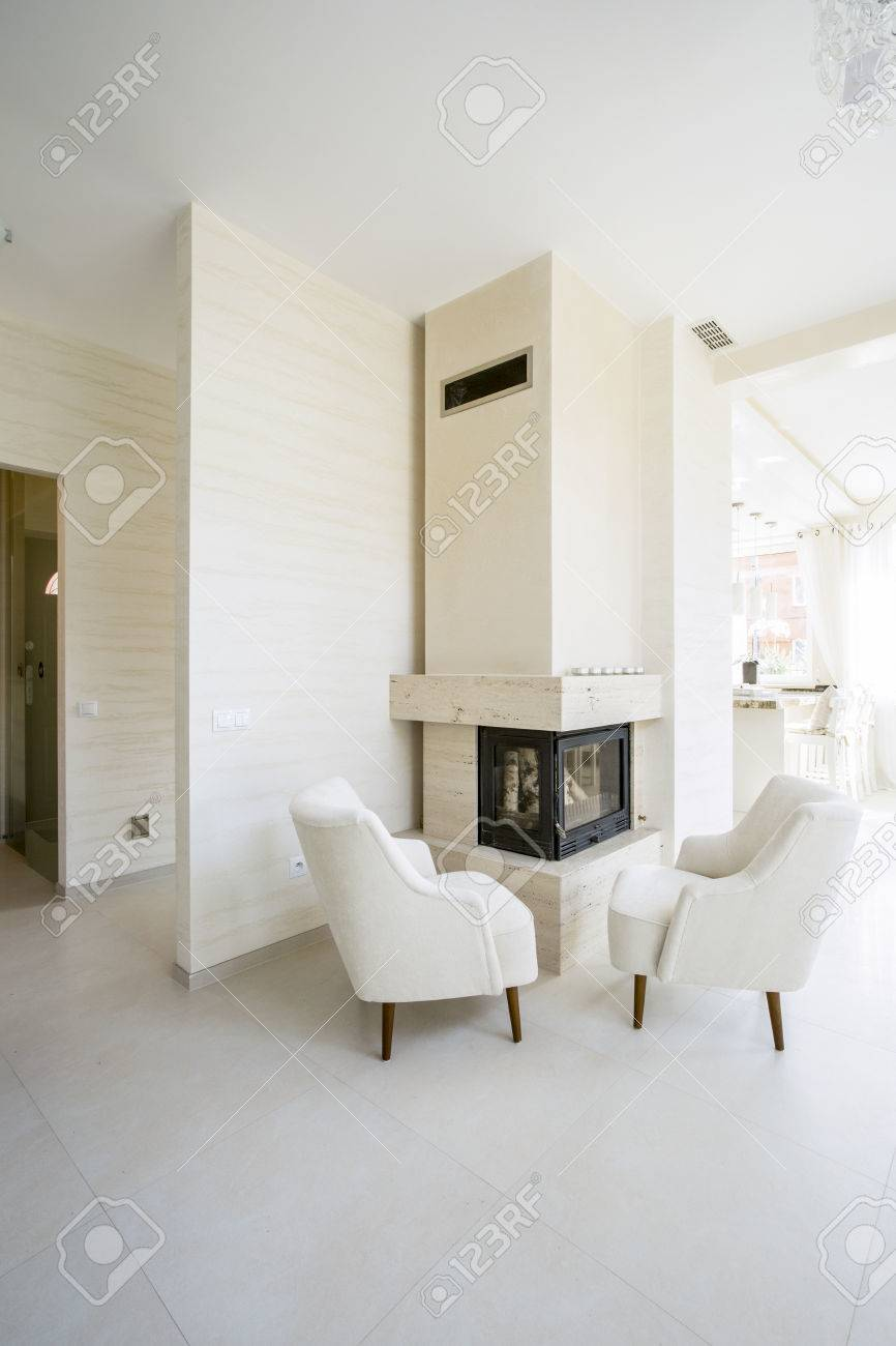 Modern Fireplace In White, Spacious Living Room Stock Photo, Picture ...