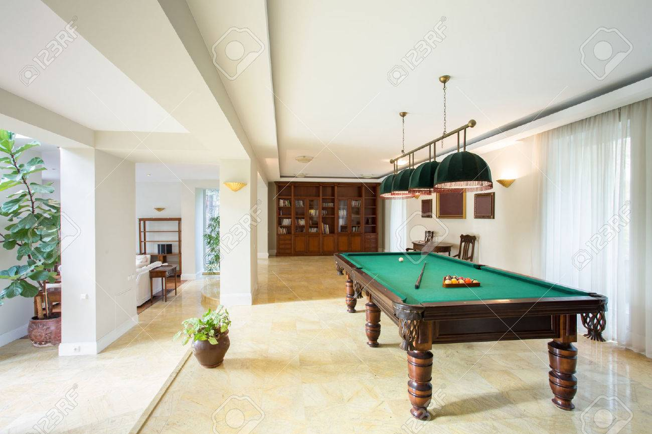 Billiard Table In Living Room In Luxury Apartment Stock Photo ...