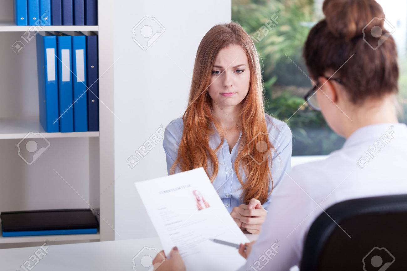 stressed girl on a job interview in office stock photo picture stock photo stressed girl on a job interview in office