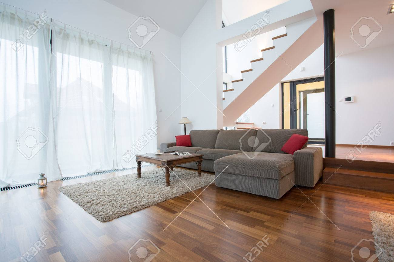Carpet In Living Room. Wooden parquet and small carpet in living room Stock Photo  35478441 Parquet And Small Carpet In Living Room