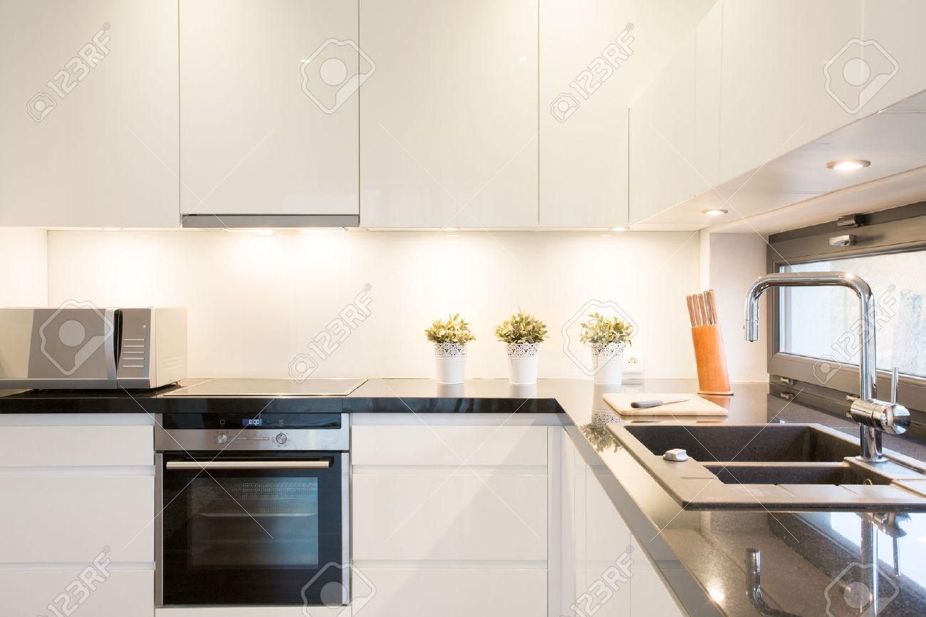 White Kitchen Unit Designs close-up of white kitchen unit in modern interior stock photo