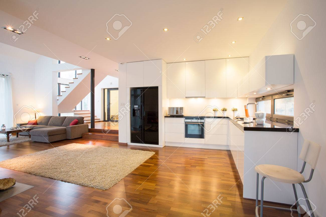Open Kitchen And Drawing Room In Luxury Mansion Stock Photo