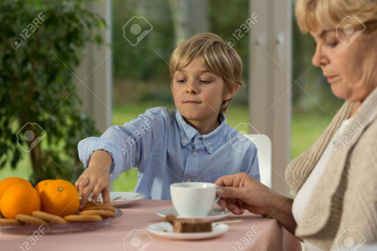 granny boy Little boy and his granny eating the cake on lazy afternoon Stock Photo -  35521978