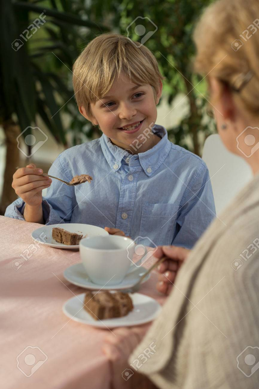 granny boy Smiling little boy and his granny during five o'clock tea Stock Photo -  35522016