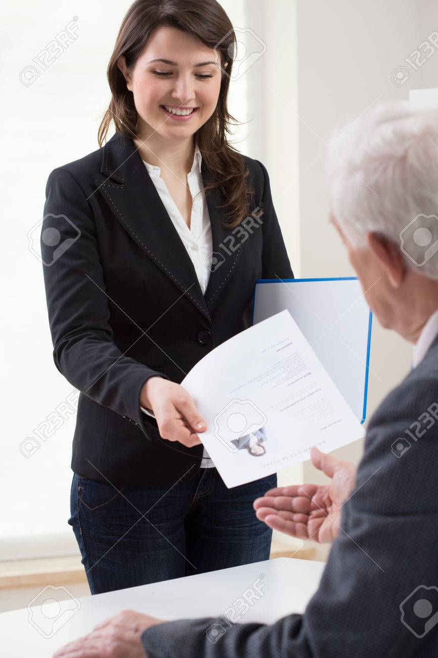 Young Smiling Woman Presenting Curriculum Vitae On Job Interview