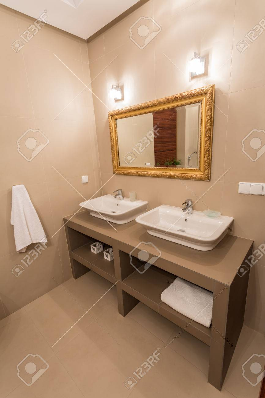 Mirror With Gold Frame In Luxury Bathroom Stock Photo Picture And. Gold Bathroom Mirrors