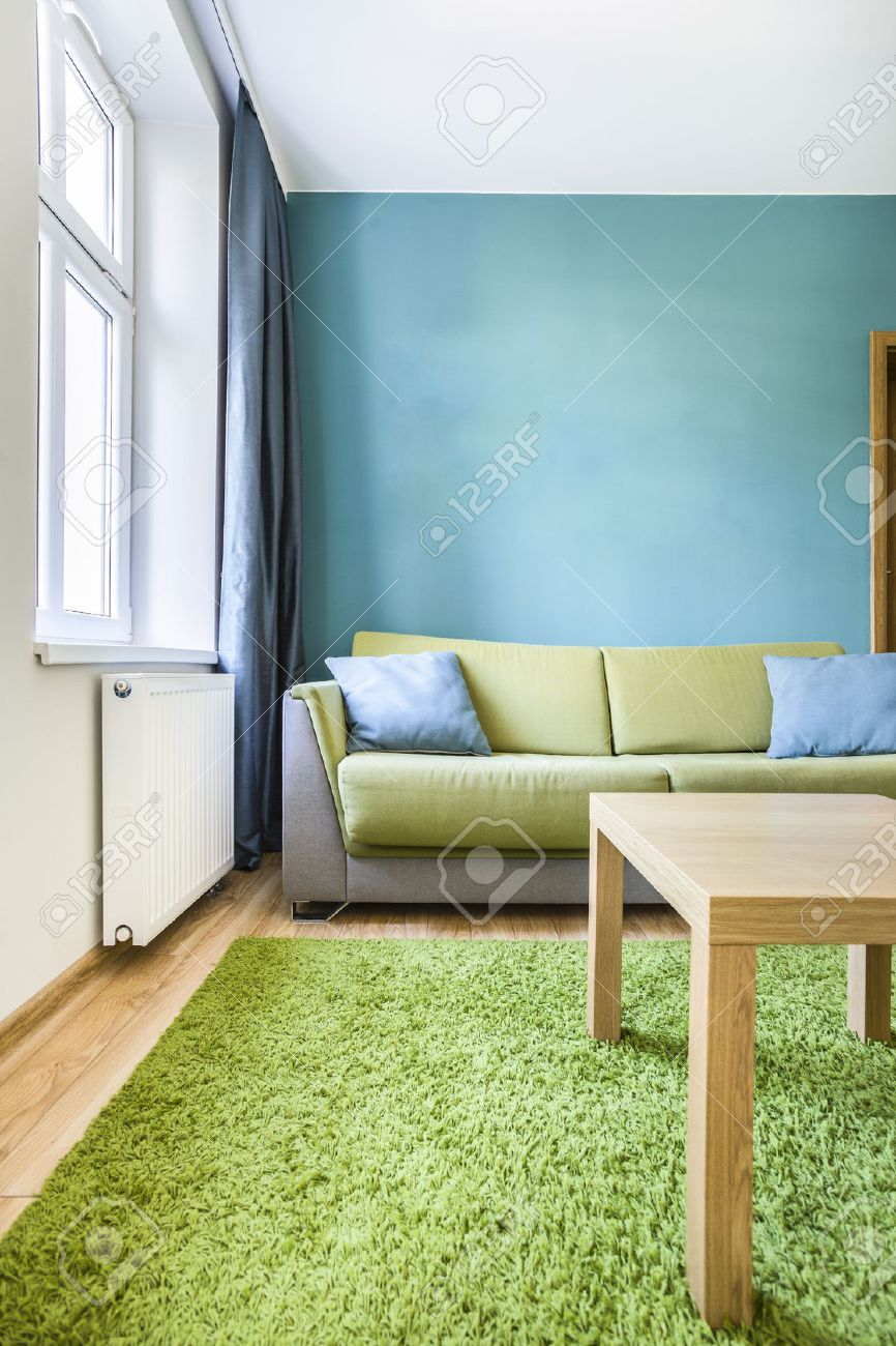 small cozy room with green and cyan details stock photo, picture