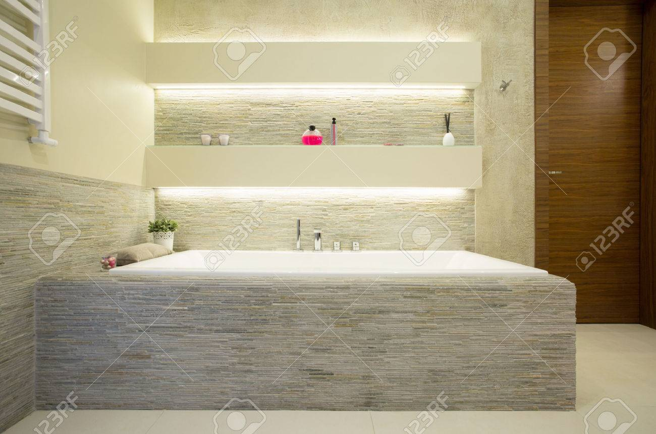 Illuminated Comfortable Bath In Luxury Bathroom Stock Photo, Picture ...