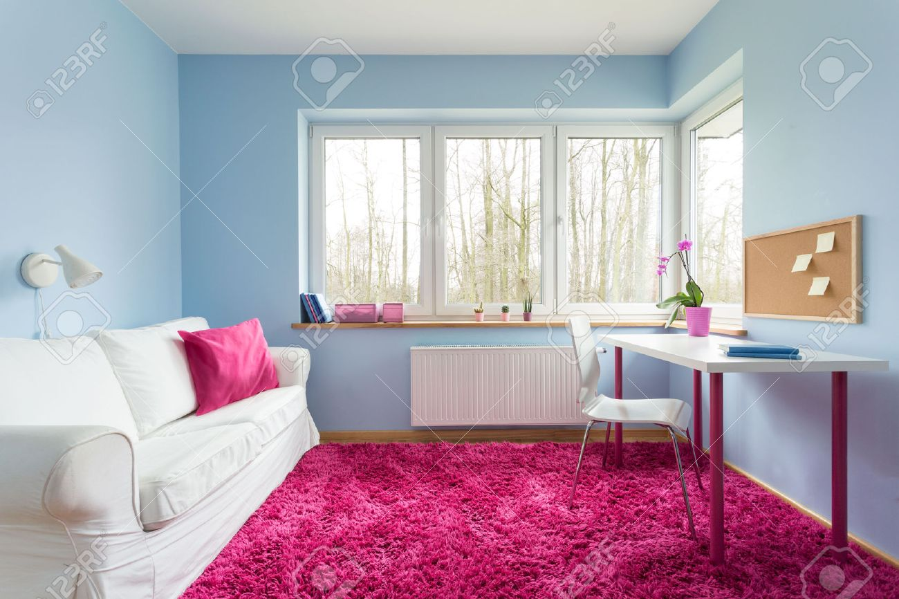 . Beautiful modern room with blue walls and pink soft carpet