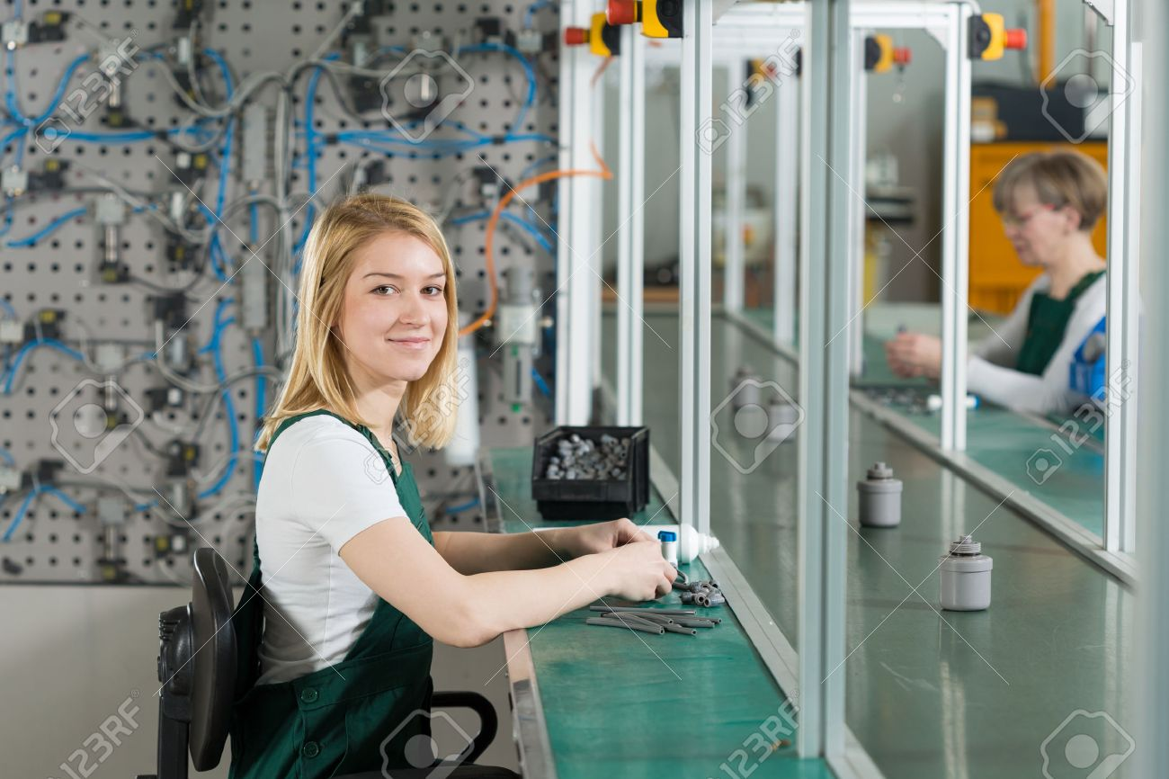 Young Female Production Worker In Manufacturing Plant Photo – Production Worker