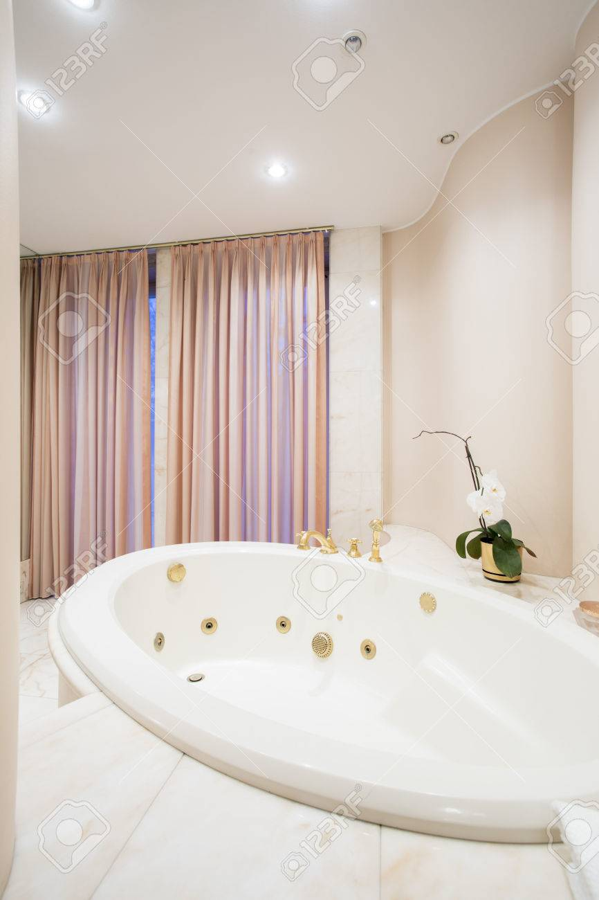 Big Round Bathtub With Massage In Old Fashioned Bathroom Stock Photo ...