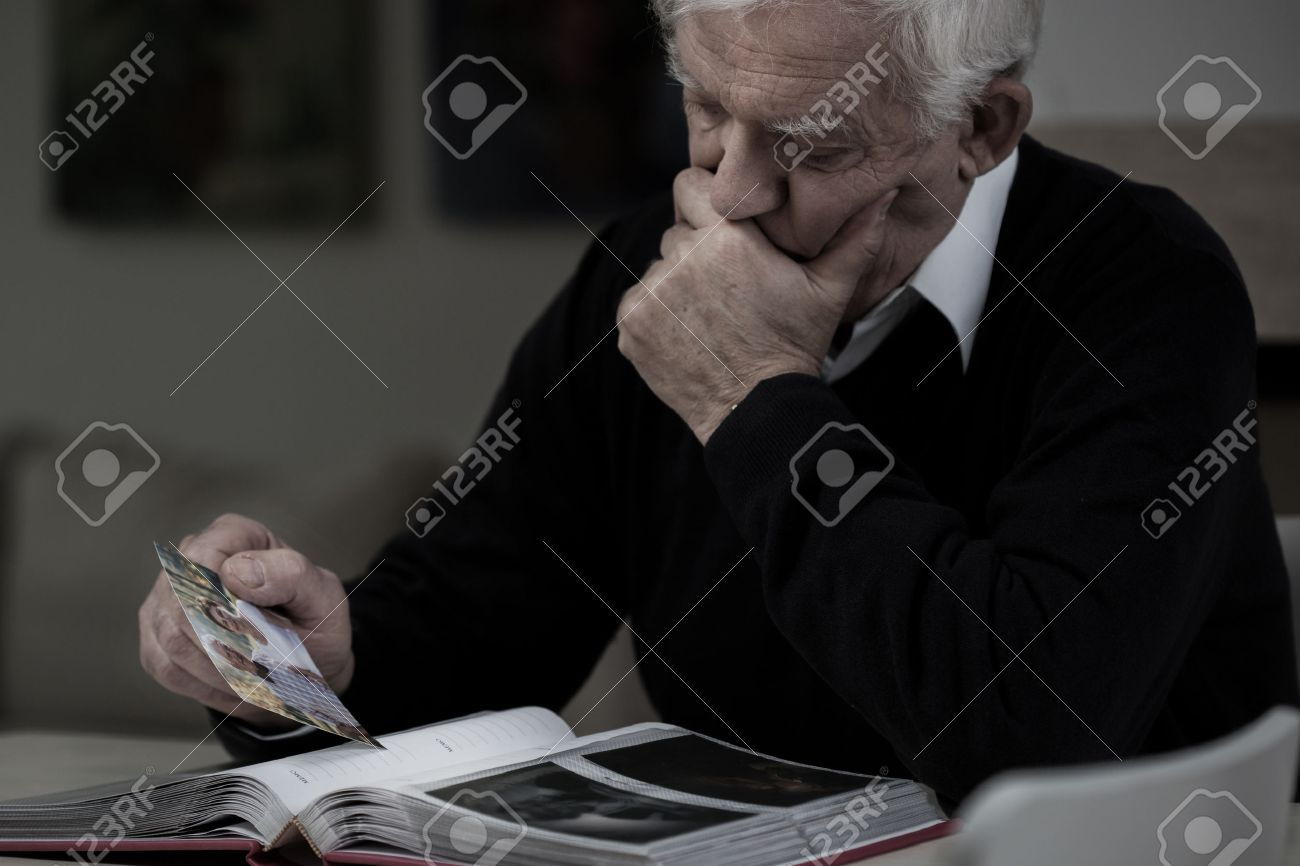 http://previews.123rf.com/images/bialasiewicz/bialasiewicz1504/bialasiewicz150400966/38884370-Senior-sad-man-with-photo-missing-his-wife-Stock-Photo-old.jpg